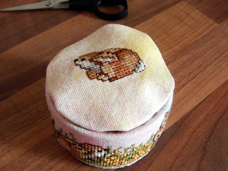 Place top stitched fabric onto can.